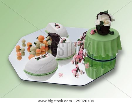 Springtime marzipan food arrangement on green