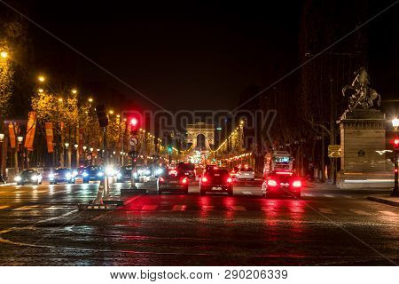 Paris, France - November 3, 2018: Night Traffic On Champs-elysees With Arc De Triomphe In Background