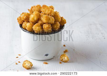 Close Up Of Rustic Fried Golden Potato Tater Tots