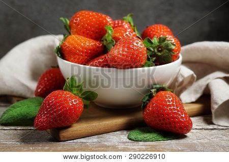 Strawberry Concept With A Group Of Ripe Red Strawberries In A White Bowl Close Up Frontal View On A