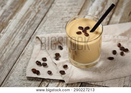 Cold Coffee Cream Milkshake Smoothie Drink In A Glass Topped With Coffee Beans On A Wooden Rustic Ta