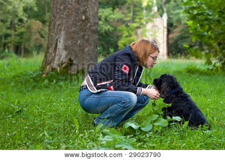 Girl talking to her dog in the park poster