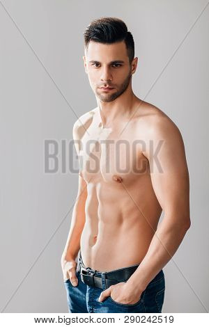 Sexy Muscular Shirtless Man Posing In Studio. Male Beauty
