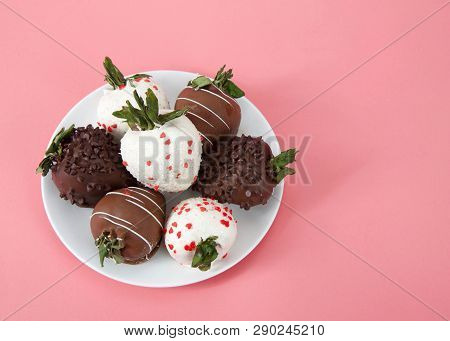 Variety Of Chocolate Covered Strawberries On A Plate. Dark, White And Milk Chocolate On A Pink Backg