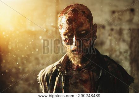 A portrait of a creepy scary zombie. Halloween. Horror film. poster