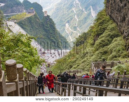 Zhangjiajie/china-15 October 2018:unacquainted Tourists Climb Up And Down To Heaven Gate Cave On Hea