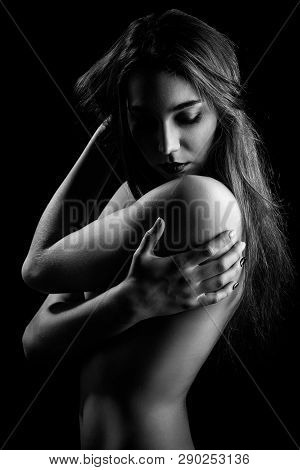 topless sensual woman, closed eyes on black background, monochrome poster