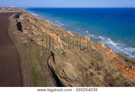 Mountain Landslide In An Environmentally Hazardous Area. Large Crack In Ground, Descent Of Large Lay