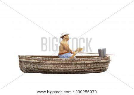 Miniature People Sit In A Boat On White Background With Clipping Path