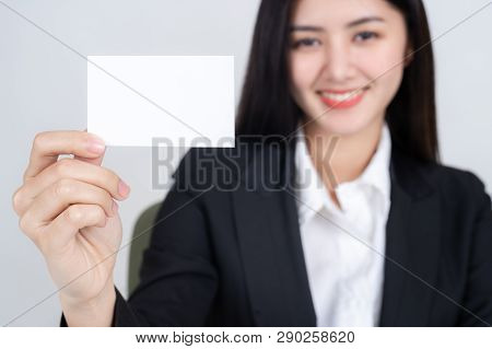 Business Woman  Holding And Showing Empty Business Card Or Name Card - Business Concept