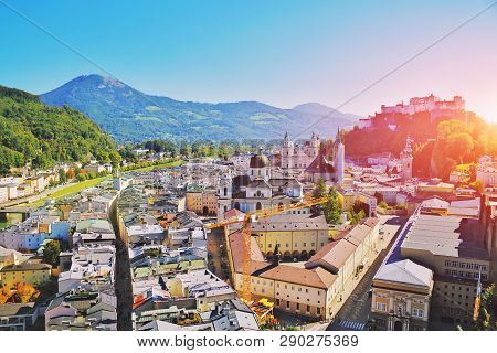 Aerial View Of The Historic City Of Salzburg With Festung Hohensalzburg Fortress And Salzburger Dom.