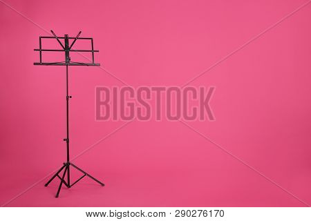 Empty Music Note Stand On Color Background. Space For Text