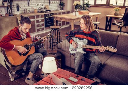 Musicians Wearing Jeans Composing New Melody For The Song