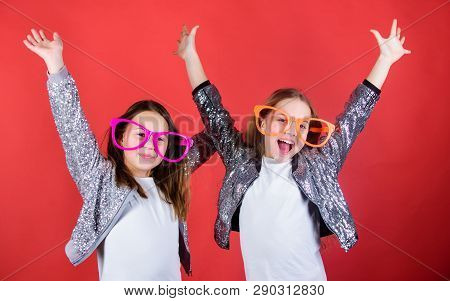 Keep Celebrating. Cool Party Girls Wearing Fancy Glasses. Small Kids In Party Goggles Having Fun. Pa