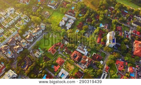 Aerial View Of Residential Neighborhood. Urban Housing Development From Above. Top View. Real Estate