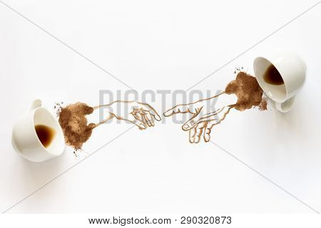 Two Espresso Cups With Hand Drawing Hand To Hand. Helping Hands, Coffee Art Or Creative Concept. Top