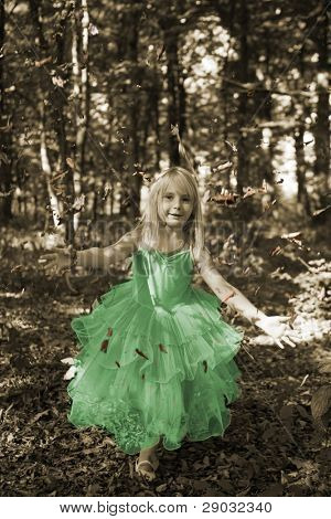 Little girl in fairy costume in the forest