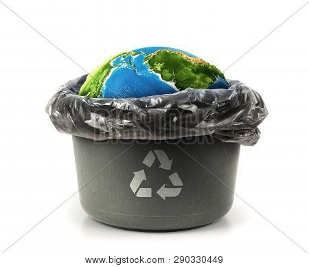 Eco Concept. Planet In The Trash Can. Isolated On A White Background.