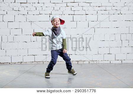 Cheerful Child Boy Dancing To Music. Cool Boy Hip Hop. Cute Fashionable Naughty Kid. Little Rapper M