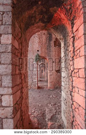 Tempio Giove Anxur In Terracina, Lazio. Arch In Sunset