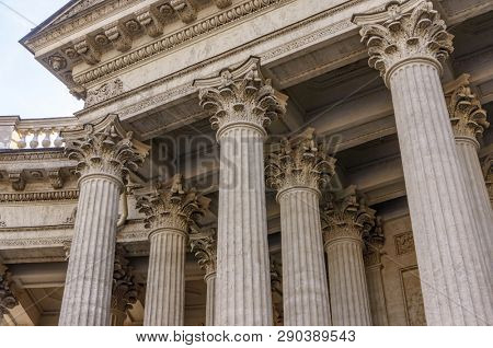 Supreme Court of the United States building front entrance with a scenic view of columns and steps under bright summer sun in Washington DC, USA