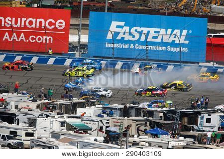 March 17, 2019 - Fontana, California, USA: Ricky Stenhouse, Jr (17) wrecks off turn one during the Auto Club 400 at Auto Club Speedway in Fontana, California.