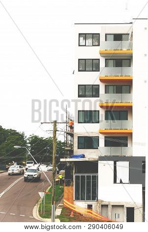 Gosford, New South Wales, Australia - March 18, 2019: Workmen Dismantling Scaffolding And Removing S