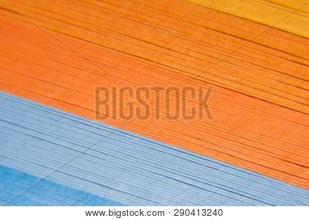 Colored paper strips as a colorful backdrop. The colored paper on a background.