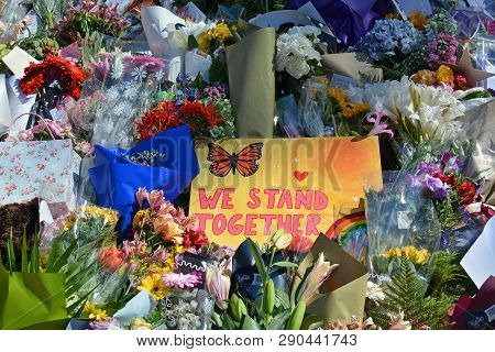 Christchurch, New Zealand - March 19, 2019; Floral Tribute & We Stand Together Message Of Love From