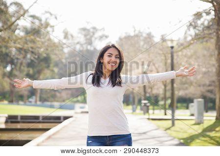 Careless Positive Student Girl Walking Outside. Beautiful Young Woman In Casual Enjoying Weekend In