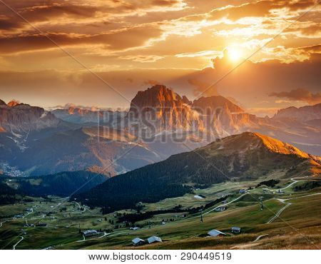Evening view of the Val Gardena in Dolomite mountains. Location place Dolomiti, Seceda peak, Trentino Alto Adige, province Bolzano, Italy, Europe. Nature wallpapers. Discover the beauty of earth.