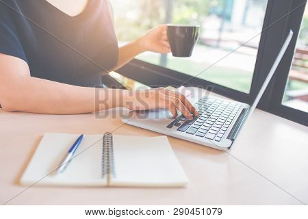 Woman Hand Is Using A Laptop Computer In Office.