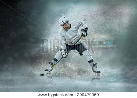 Caucassian ice hockey Player in dynamic action in a professional sport game, play in hockey. Sport, power, dynamic, athlete, game, hockey concept.