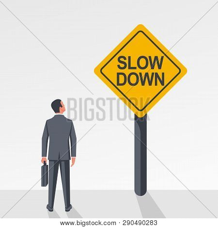 Businessman Looks At A Yellow Sign Slow Down. Vector Illustration Flat Design. Isolated On White Bac