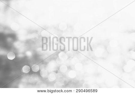 Winter Black Seasonal Bokeh Background. Gray Bokeh Light Backgrounds. Silver Bubble Background. Abst