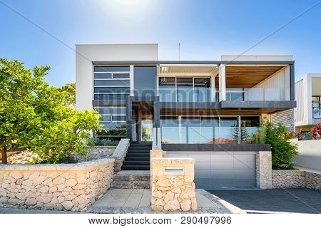 Front Elevation Of A Large Double Storey Modern Home In Perth, Western Australia. Photographed: Janu