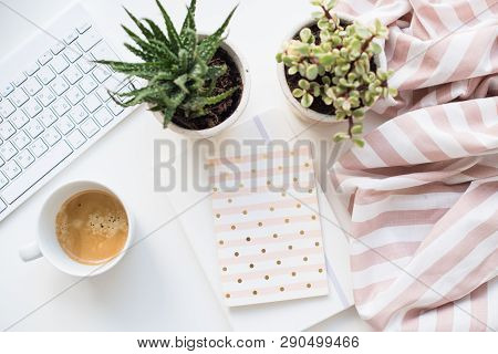 Minimalist Ladys Flat Lay Workplace Decoration With Coffee Cup And Keypad