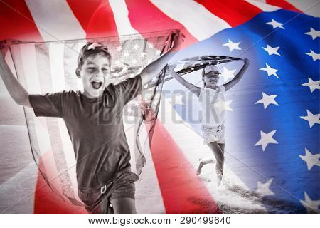 Close-up of crumbled American flag against happy children taking an american flag