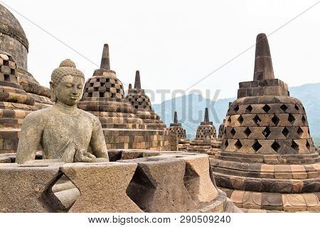 Buddah Statue With Ancient Stupas In Borobudur Buddhist Temple