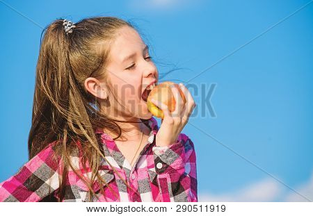 Apple Fruit Diet. Kid Hold Ripe Apple Sunny Day. Kid Girl With Long Hair Eat Apple Blue Sky Backgrou