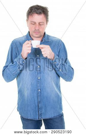 Young Man Having Cup Of Coffee Look Down