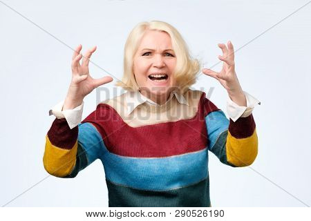 Angry Old Woman Making Angry Facial Gesture On White Background