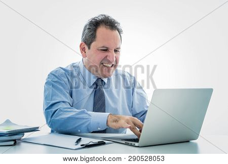 Overwhelmed And Desperate Mature Businessman Working With Laptop Feeling Angry And Furious At Office