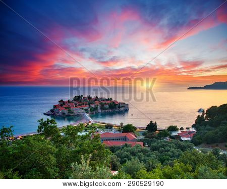 Dramatic view of the small islet Sveti Stefan. Location place Montenegro, Adriatic sea, Europe. Scenic image of most popular european travel destination. Summer vacation. Discover the beauty of earth.