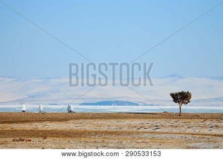 Ice Boat Rides On The Ice Of Lake Baikal In The Background Olkhon In The Winter Foggy Morning Away