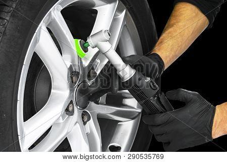 Car Polish Wax Worker Hands Polishing Car Wheel. Buffing And Polishing Car Disc. Car Detailing. Man