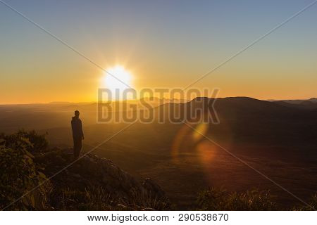 Man Enjoying Sunset After A Hike To The Top Of Mount Sonder Just Outside Alice Springs, West Macdonn