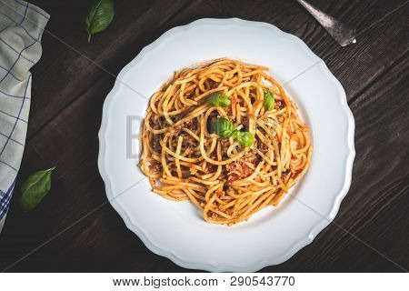 Italian Spaghetti Bolognese. Traditional Pasta With Bolognese Sauce On White Plate On Wood Table Top
