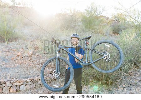 Powerful Mountain Biker Showing Off His Strength By Picking Up Bike With One Hand
