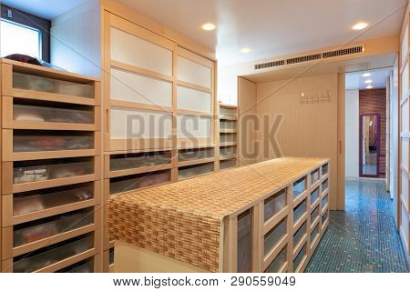 Giant walk-in closet with drawers. Nobody inside